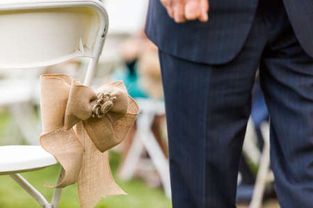 priced: Outdoor wedding ceremony of small late summer wedding. Stock Photo