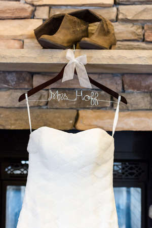 high priced: Wedding dress hanging in a lobby of contemporary hotel.