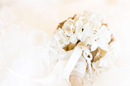 priced: Brides bouquet made from fabric flowers on budget.
