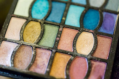 priced: Used multicolor eye shadows of makeup artist. Stock Photo