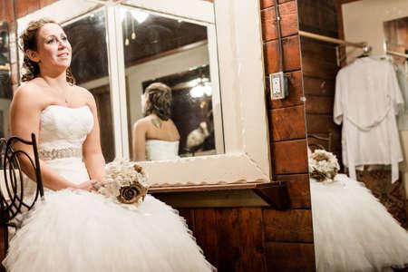 Bride wating in her room for start of wedding ceremony.