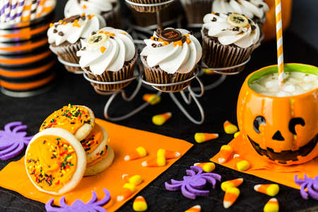 trick or treating: Chocolate Halloween cupcakes with white buttercreme icing and chocolate shavings on top.