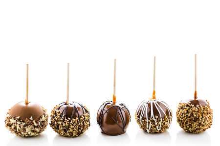 Hand dipped caramel apples decorated for Halloween. Stock Photo
