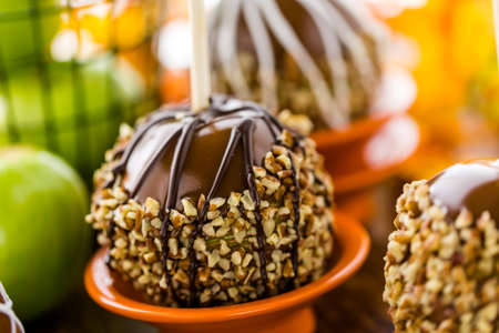 taffy apple: Hand dipped caramel apples decorated for Halloween. Stock Photo