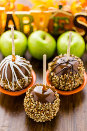 dipped: Hand dipped caramel apples decorated for Halloween. Stock Photo