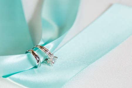 Wedding wings on blue ribbon. Stock Photo