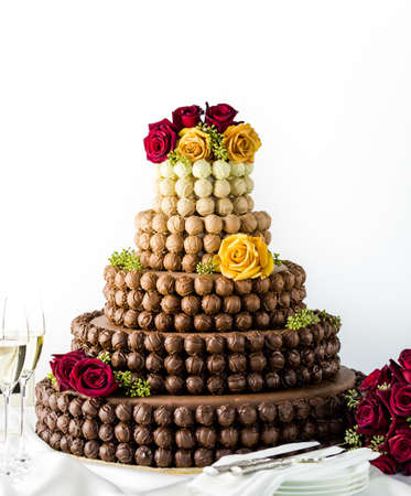 Gourmet tiered wedding cake as centerpiece at the wedding reception. photo