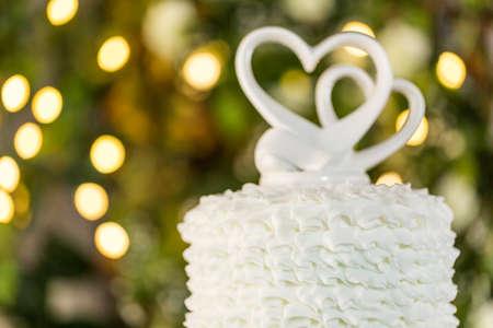 centerpiece: Gourmet tiered wedding cake as centerpiece at the wedding reception.