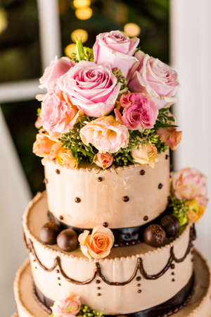 Gourmet tiered wedding cake at wedding reception. photo