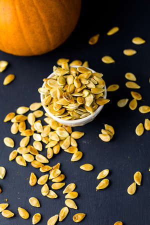 home cooked: Home  cooked pumpkin seeds on black background.