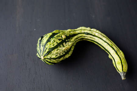 dried gourd: Organic miniature gourds on black background. Stock Photo