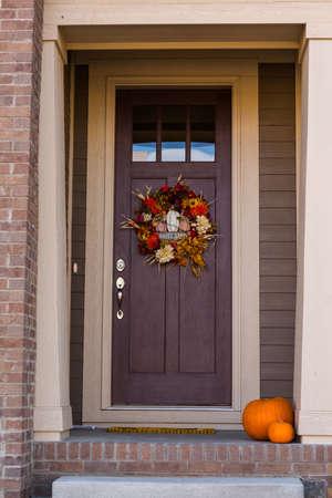 Autumn wreath decorating front door.