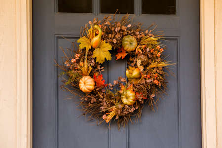 Autumn wreath decorating front door.