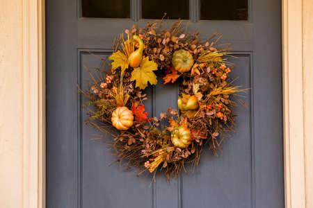 fall season: Autumn wreath decorating front door.
