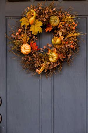 Autumn wreath decorating front door. photo