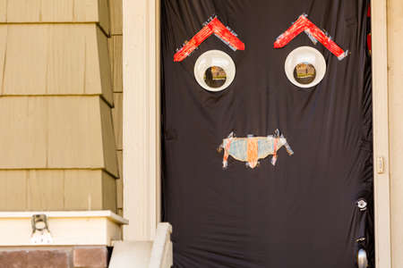 Residential house decorated for Halloween holiday. photo