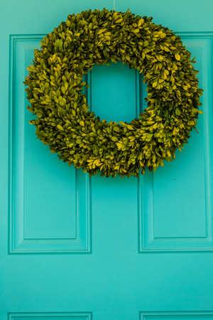 living unit: Green wreath decorating front door.
