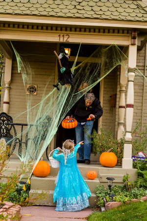 Denver, Colorado, USA-October 31, 2014. Trick or treating in costumes on Halloween night. Editorial