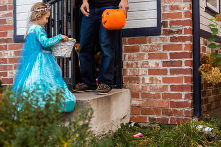treating: Trick or treating in costumes on Halloween night.