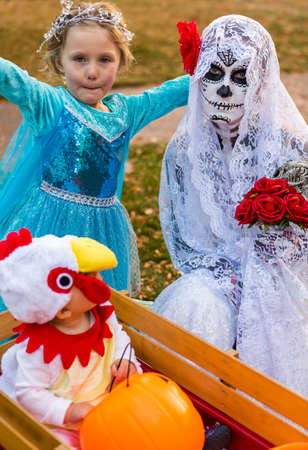 Trick or treating in costumes on Halloween night. photo