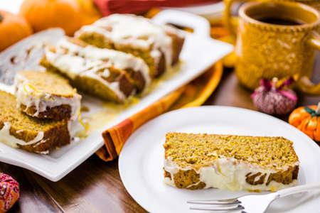 glazing: Homemade pumpkin bread with orange glazing on top.