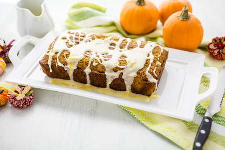 glazing: Homemade pumpkin bread with orange glazing on top.