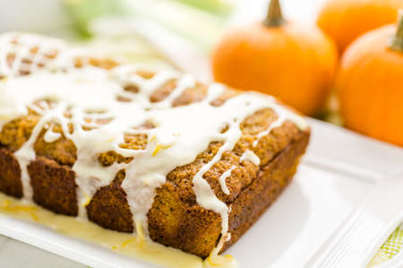 Homemade pumpkin bread with orange glazing on top.