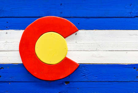 Handmade flag of Colorado state from wood and painted.