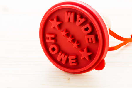 made: Red cookie stamp with home made stamp. Stock Photo
