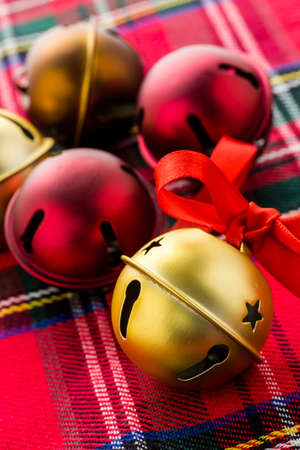 Multicolor jingle bells with red ribbon. Stock Photo