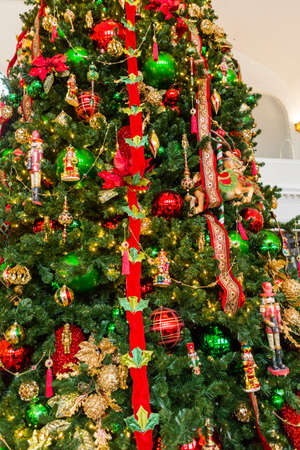 large christmas tree decorated with bright ornaments stock photo 33946957