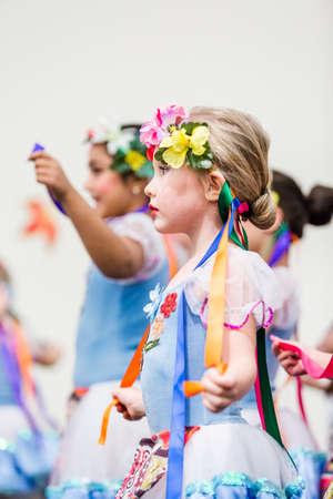 Denver, Colorado, USA-November 15, 2014. Kids dancing tradition Russian folk dances.