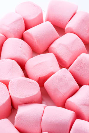 Round large pink marshmallows on a white backgrouns.