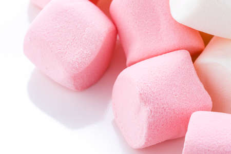 Round white and pink marshmallows on a white backgrouns.