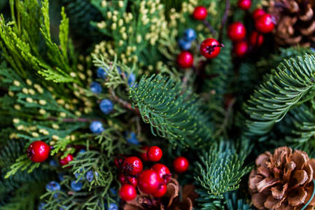 pinecones: Close up of Christmas wreath decorated with pinecones and berries. Stock Photo