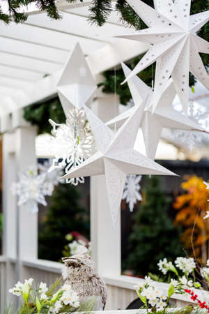 front porch: Front porch decorated with snowflakes for Christmas.
