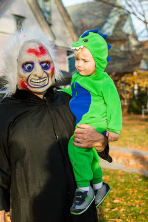 boy 12 year old: Trick or treating in costumes on Halloween night.