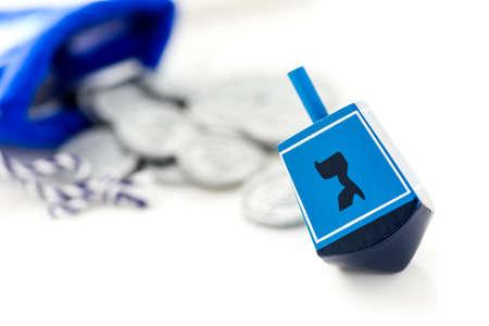 dreidel bears: Blue dreidel with silver tokens on a white background Stock Photo