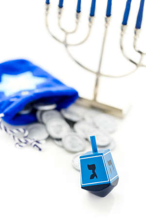 tokens: Blue dreidel with silver tokens on a white background Stock Photo
