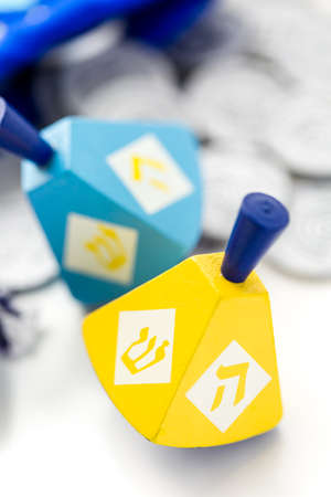dreidel bears: Colorful dreidels with silver tokens on a white background Stock Photo