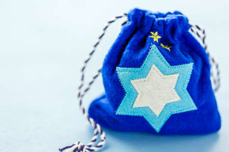 chanukkah: Handmade bag with Star of David on blue background. Stock Photo