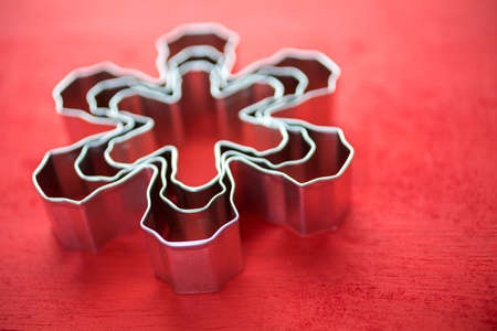 Different size metal cookie cutters in shape of snow flakes. Stok Fotoğraf