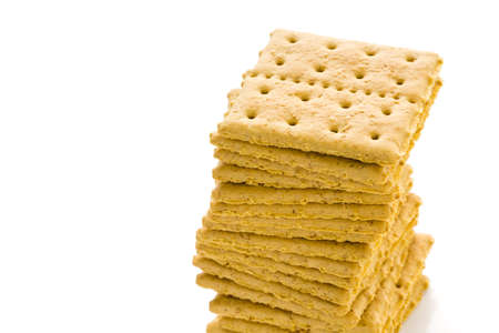 Stack of graham crackers on a white background.