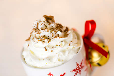 chocolate shavings: Hot chocolate garnished with whipped cream and chocolate shavings.