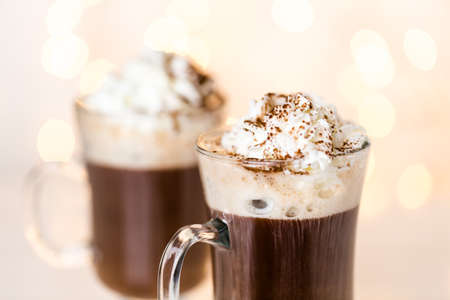 chocolate powder: Hot chocolate garnished with whipped cream and cocoa powder.