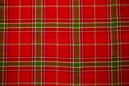 Christmas plaid table cloth as a background.