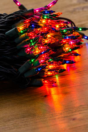 String of multicolor Christmas lights with green wiring.