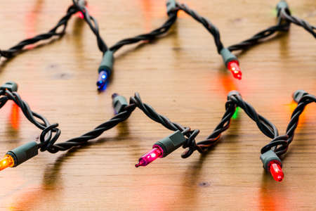 string lights: String of multicolor Christmas lights with green wiring.
