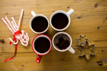 Cups with hot chocolate on wood table.