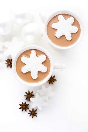 Homemade hot chocolate garnished with snowflake shaped white marshmallows. Reklamní fotografie